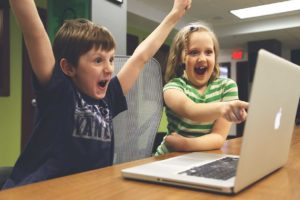 Turn Prospects into clients kids at computer cheering